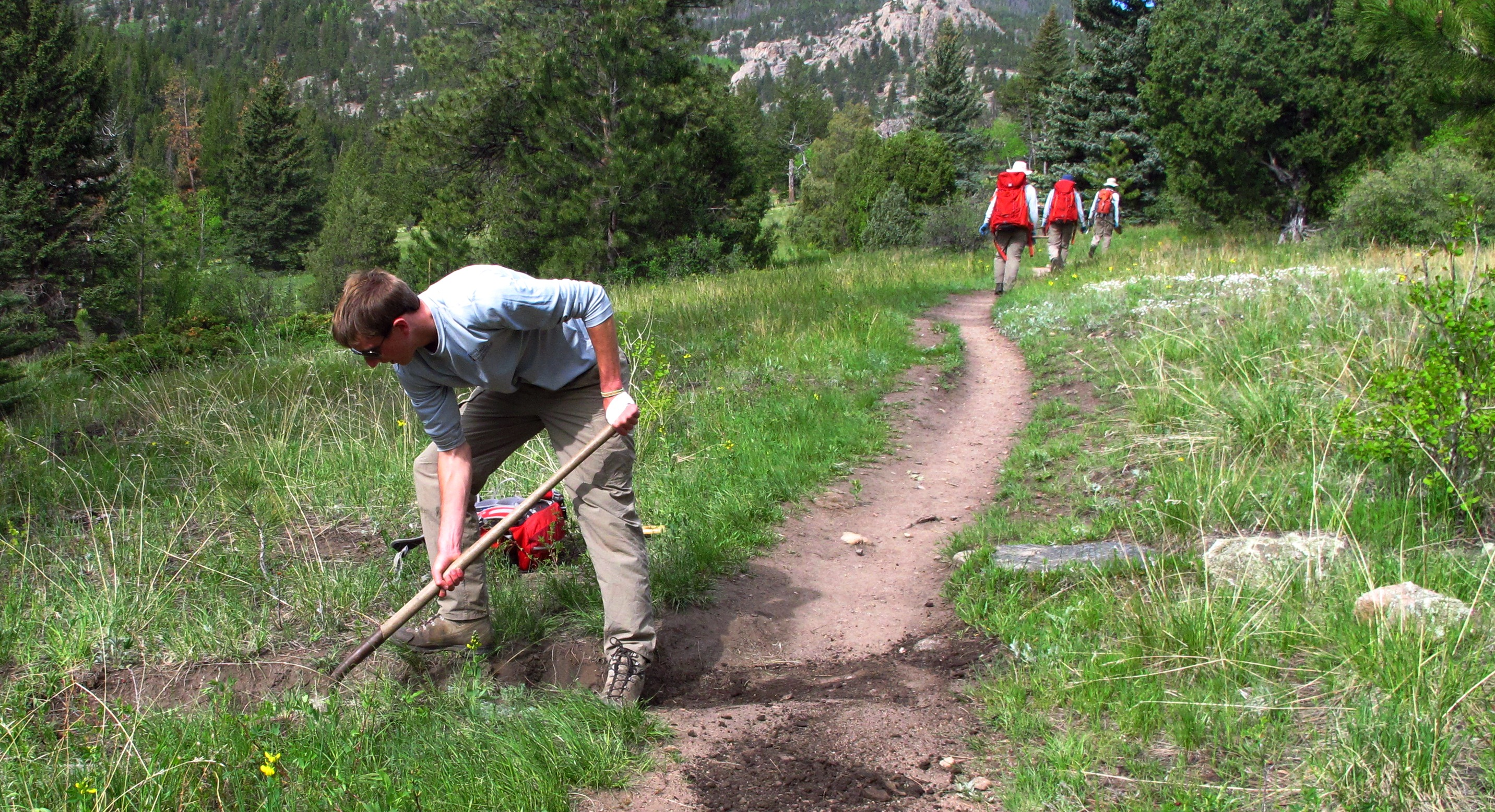 Tom clearing a drain on the Cow Creek Trail